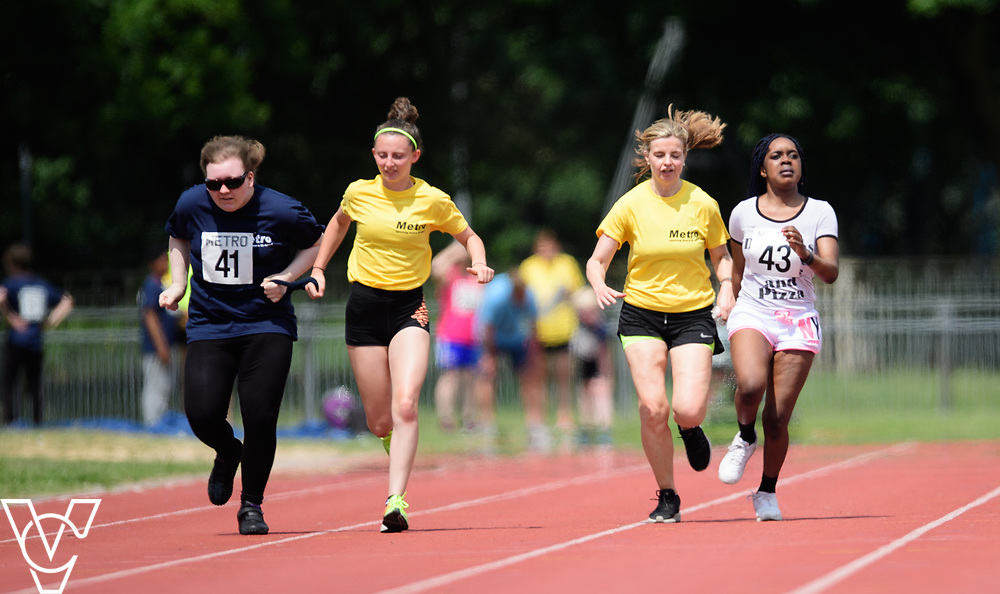Metro Blind Sport's 2017 Athletics Open held at Mile End Stadium.  100m. Hannah Bromley-Challenor with guide runner, left, and Precious Ntumy-Kamara with guide runner<br /> <br /> Picture: Chris Vaughan Photography for Metro Blind Sport<br /> Date: June 17, 2017