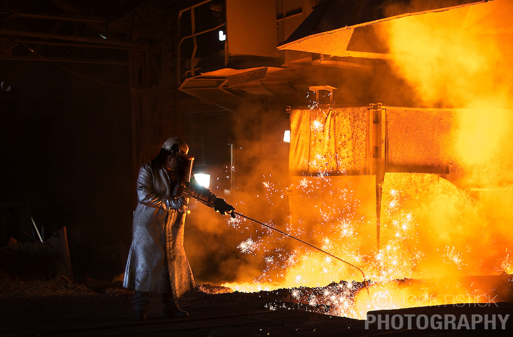 An Arcelor-Mittal employee is dressed in protective clothing to guard against the 1400 celsius degree heat generated by blast furnace B, at the Ougree facility near Liege, Belgium, Monday, Feb. 9, 2009.  (Photo © Jock Fistick)