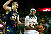 WACO, TX - JANUARY 28: Royce O'Neale #00 of the Baylor Bears drives to the basket against Kevin Noreen #34 of the West Virginia Mountaineers on January 28, 2014 at the Ferrell Center in Waco, Texas.  (Photo by Cooper Neill/Getty Images) *** Local Caption *** Royce O'Neale; Kevin Noreen