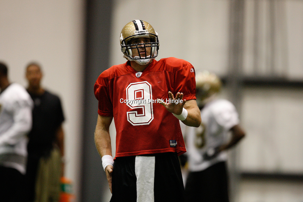 July 30, 2010; Metairie, LA, USA; New Orleans Saints quarterback Drew Brees (9) during a training camp practice at the New Orleans Saints indoor practice facility. Mandatory Credit: Derick E. Hingle-US PRESSWIRE