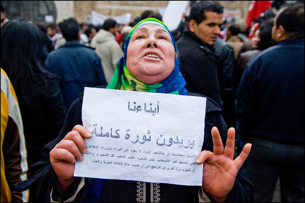 """Protesters of the 'Caravan of Freedom' continue their sit-in on the Kasbah square in Tunis, Tunisia on January 24, 2011. Protesters said they will continue their sit-in until the fall of the interim Government and satisfaction of their demands for decent life. Copyright Benjamin Girette /// On january the 14th 2011, Zine el-Abidine Ben Ali President of Tunisia and his famous wife Leila Trabelsi as know as """"The regent of Carthage"""" are forced by thousands of protesters to escape the country after 24 years of power. As a result a new democraty is in design for the next six months until Tunisians organize national democratic elections, it might be the birth of the first democraty in the arab world.."""