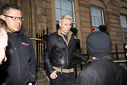 Green Day's Mike Dirnt speaks to fans after the American rock band's concert in front of 35,000 expectant fans at Bellahouston Park, Glasgow, was called off just hours beforehand because of bad weather. Green Day stayed at the Blythswood Square Hotel, Glasgow.