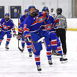 TORONTO, ON  - OCT 29,  2017: Ontario Junior Hockey League game between the Toronto Jr. Canadiens and the Toronto Patriots, Jason Pineo #21 of the Toronto Jr. Canadiens celebrates the goal during the third period. <br /> (Photo by Andy Corneau / OJHL Images)