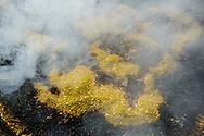 Smoke rises from a cauldron of burning incense next to the Boudhanath Stupa in Kathmandu, Nepal.
