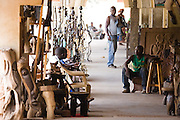 Vendors wait in their stores at the Village Artisanal de Ouagadougou, a cooperative that employs dozens of artisans who work in different mediums, in Ouagadougou, Burkina Faso, on Monday November 3, 2008.