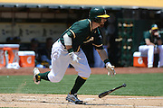 May 29, 2014; Oakland, CA, USA; Oakland Athletics second baseman Eric Sogard (28) bats during the second inning against the Detroit Tigers at O.co Coliseum. The Tigers defeated the Athletics 5-4.
