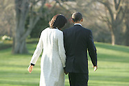 President Barack Obama and First Lady Michelle Obama walk hand in hand to Marine One on their way to Andrews Air Force Base and Air Force One which will take them to London for the Economic Summit. Photograph by Dennis Brack