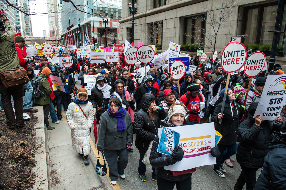 Students, parents, and teachers march in downtown Chicago in opposition of the closing of 53 Chicago public schools.