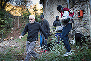 November 8, 2016,  Breil-sur-Roya, French Alpes, France. Sylvain, 67 years, a retired school teacher, guides   Eritrean refugees who spent the night in the house of Elo&iuml;se, to his van in order to transport them over the mountains to a safe train station. By doing so Sylvain risks police arrests and a trial.<br /> <br /> 8 novembre 2016, Breil-sur-Roya, Alpes <br /> fran&ccedil;aises, France. Sylvain, 67 ans, prof de math &agrave; la retraite, guide des r&eacute;fugi&eacute;s &eacute;rythr&eacute;ens, qui ont pass&eacute; la nuit dans la maison d'Elo&iuml;se, vers sa camionnette pour les transporter &agrave; travers la montagne jusqu'&agrave; une gare jug&eacute;e s&ucirc;re. Sylvain risque une  arrestation polici&egrave;res et un proc&egrave;s.