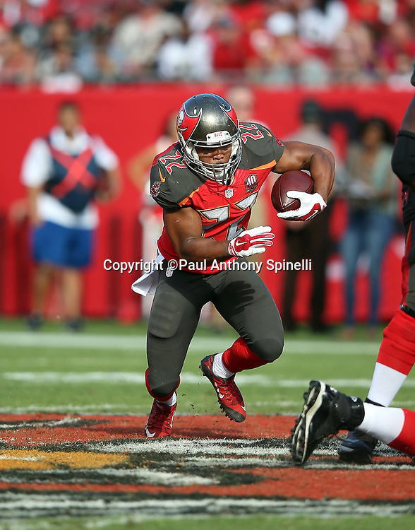 Tampa Bay Buccaneers running back Doug Martin (22) runs the ball during the 2015 week 14 regular season NFL football game against the New Orleans Saints on Sunday, Dec. 13, 2015 in Tampa, Fla. The Saints won the game 24-17. (©Paul Anthony Spinelli)