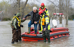 A man is assisted by Surete du Quebec police officers after being evacuated from his home in the town of Rigaud, Quebec, Canada., west of Montreal, Monday, May 8, 2017, following flooding in the region. Photo by Graham Hughes /The Canadian Press/ABACAPRESS.COM