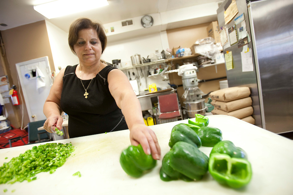 London, Ontario ---10-09-24--- Kyriaki Antoniou cuts peppers at Cyprus Pizza in London, Ontario which she co-owns with her brother-in-law Tony. Kyriaki recently underwent a new weight loss procedure which inserts a balloon into the stomach. Since the procedure a month ago she has lost over 20 pounds.<br /> GEOFF ROBINS The Globe and Mail