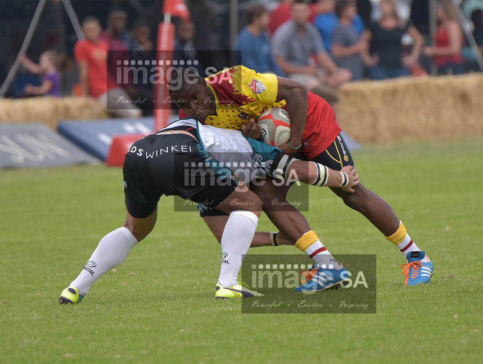 HARTSWATER, SOUTH AFRICA - Saturday 11 April 2015,  during the Vodacom Cup rugby match between GWK Griquas and Border Bulldogs at the Hartswater Rugby Club in the Northern Cape Province.JW Jonker from Gwk Griquas and Makazole Mapimpi from the Border Bulldogs<br /> Photo by Charl Devenish/ ImageSA / SARU