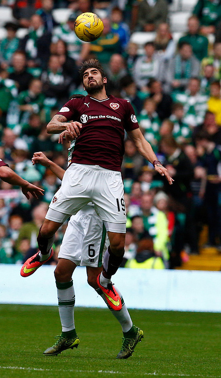 Celtic v Hearts....Nadir Ciftci Juanma Delgado leaps high for the ball..(c) STEPHEN LAWSON | SportPix.org.uk