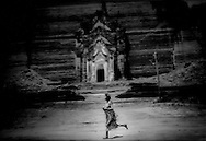 Burmese girl running, Mingyun, Burma.