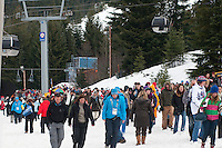 A crowd of spectators lines up outside the Whistler Sliding Centre for the 4-man bobsleigh finals during the 2010 Olympic Winter Games in Whistler, BC Canada.