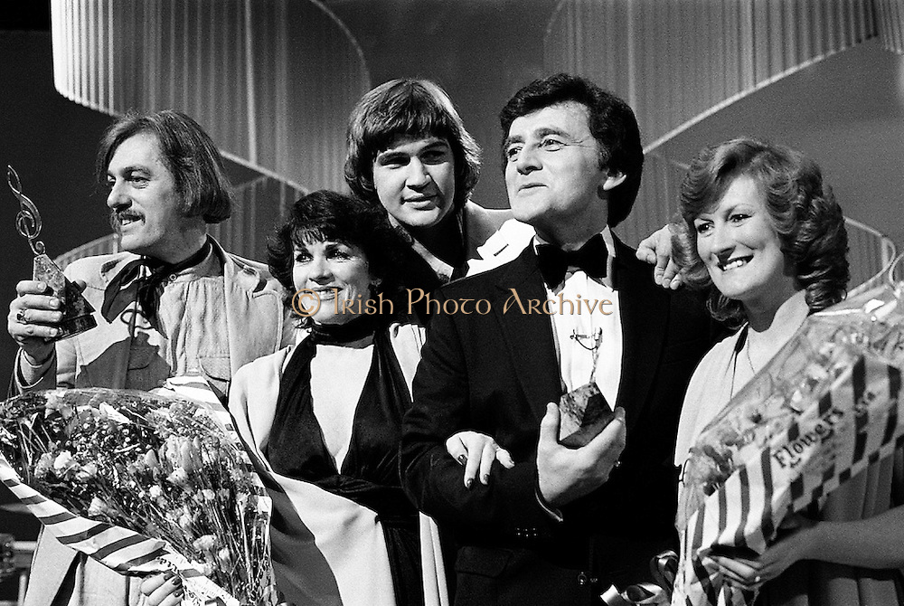 Victory celebrations at the sixteenth National Song Contest. Shay Healy (left), who wrote the winning song 'What's Another Year', with singer Johnny Logan and compère Larry Gogan (right), at RTÉ Montrose, Dublin.<br />