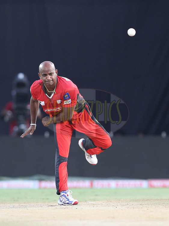 Sanath Jayasuriya of the Ruhunu Eleven sends down a delivery to Abdul Razzaq of the Leicestershire Foxes during the CLT20 - Q5 match between Leicester Foxes and Ruhunu Eleven held at the Rajiv Gandhi International Stadium, Hyderabad on the 21st September 2011..Photo by Shaun Roy/BCCI/SPORTZPICS