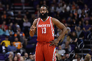 Feb 4, 2016; Phoenix, AZ, USA;  Houston Rockets guard James Harden (13) points on the court in the game against the Phoenix Suns at Talking Stick Resort Arena. Mandatory Credit: Jennifer Stewart-USA TODAY Sports