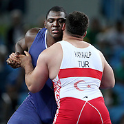 Wrestling - Olympics: Day 10   Mijain Lopez Nunez of Cuba in action against Riza Kayaalp, (right), Turkey, in the Gold Medal bout in the Men's Greco-Roman 130 kg Final at the Carioca Arena 2 on August 15, 2016 in Rio de Janeiro, Brazil. (Photo by Tim Clayton/Corbis via Getty Images)