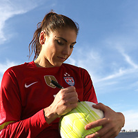 ORLANDO, FL - OCTOBER 25: Goalkeeper Hope Solo #1 of USWNT signs a ball for a fan after a women's international friendly soccer match between Brazil and the United States at the Orlando Citrus Bowl on October 25, 2015 in Orlando, Florida. The United States won the match 3-1. (Photo by Alex Menendez/Getty Images) *** Local Caption *** Hope Solo
