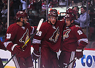 Feb. 6 2012; Glendale, AZ, USA; Phoenix Coyotes forward Boyd Gordon (15) is congratulated by teammates forward Lauri Korpikoski (28) and defensemen Adrian Aucoin  (33) after scoring against the Detroit Red Wings during the first period at Jobing.com Arena. Mandatory Credit: Jennifer Stewart-US PRESSWIRE.