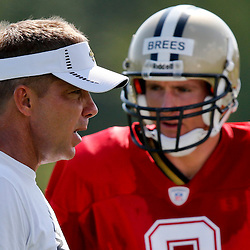 Jul 29, 2013; Metairie, LA, USA; New Orleans Saints head coach Sean Payton with quarterback Drew Brees (9) during a morning training camp practice at the team facility.  Mandatory Credit: Derick E. Hingle-USA TODAY Sports