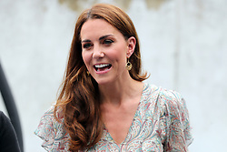 The Duchess of Cambridge takes part in a Royal Photographic Society workshop with Action for Children which uses photography to help young people develop confidence and self-expression, at Warren Park Children's Centre, Kingston upon Thames.