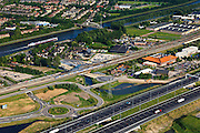 Nederland, Utrecht, Breukelen, 23-05-2011; A2 met opritten en afritten met het bekende Chinese restaurant Hotel Breukelen van het Van der Valkconcern tussen de A2 en het spoor. Amsterdam-Rijnkanaal in de achtergrond. Motorway A2 (near Utrecht) with roundabouts, railroad and channel Amsterdam-Rijnkanaal...luchtfoto (toeslag), aerial photo (additional fee required).copyright foto/photo Siebe Swart