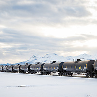 oil train carrying bakken oil headingto ward glacier national park, montana across the blackfeet reservation during the winter - contact tony@tonybynum.com for more images