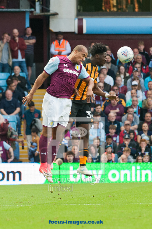 Gabriel Agbonlahor of Aston Villa and Ola Aina of Hull City in an aerial challenge during the Sky Bet Championship match at Villa Park, Birmingham<br /> Picture by Matt Wilkinson/Focus Images Ltd 07814 960751<br /> 05/08/2017