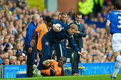 LIVERPOOL, ENGLAND - Sunday, August 30, 2009: Everton's manager David Moyes and Wigan Athletic's Hendry Thomas collide during the Premiership match at Goodison Park. (Photo by David Rawcliffe/Propaganda)