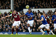 Burnley forward Chris Wood (9) Everton defender Yerry Mina (13) and Everton defender Seamus Coleman (23) go for the ball during the Premier League match between Everton and Burnley at Goodison Park, Liverpool, England on 26 December 2019.