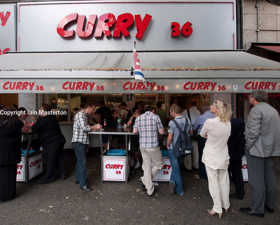 Many people eating at popular currywurst shop called Curry36 in Kreuzberg Berlin Germany