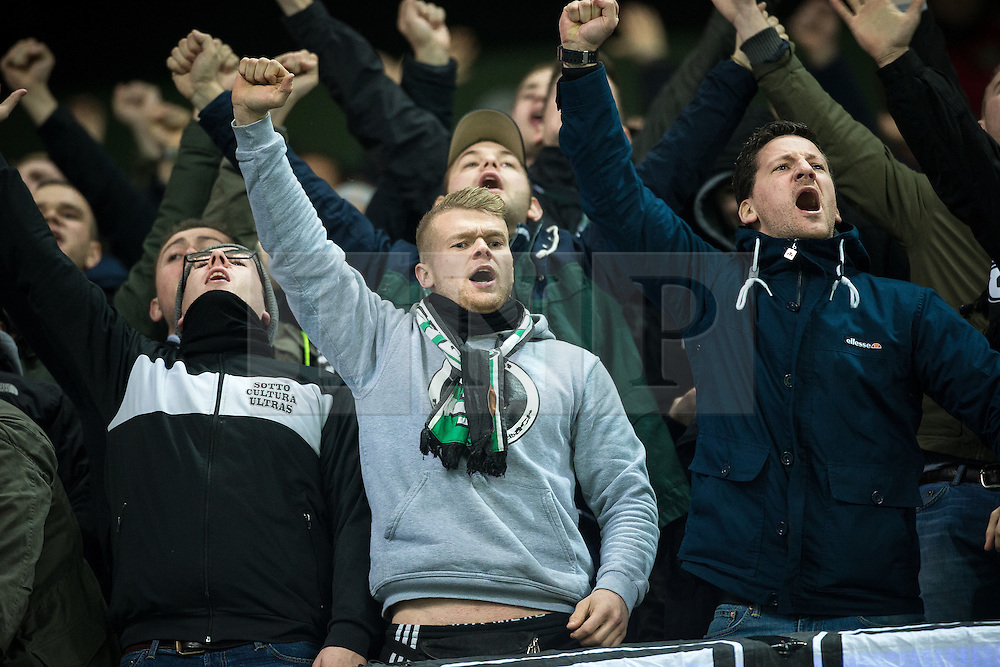 © Licensed to London News Pictures . 08/12/2015 . Manchester , UK . Borussia Monchengladbach fans watching Manchester City vs Borussia Monchengladbach in the UEFA Champions League at the Etihad Stadium . Photo credit : Joel Goodman/LNP