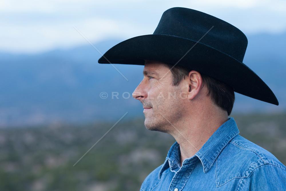 portrait of a cowboy wearing a black cowboy hat