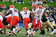 Sept. 4, 2010; Akron, OH, USA; Syracuse Orange quarterback Ryan Nassib (12) hands-off to running back Delone Carter (3) during the first quarter against the Akron Zips at InfoCision Stadium. Mandatory Credit: Jason Miller-US PRESSWIRE
