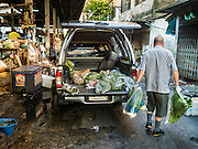 30 DECEMBER 2015 - BANGKOK, THAILAND:  A produce wholesaler makes a delivery to Bang Chak Market. The market is supposed to close permanently on Dec 31, 2015. The Bang Chak Market serves the community around Sois 91-97 on Sukhumvit Road in the Bangkok suburbs. About half of the market has been torn down. Bangkok city authorities put up notices in late November that the market would be closed by January 1, 2016 and redevelopment would start shortly after that. Market vendors said condominiums are being built on the land.           PHOTO BY JACK KURTZ