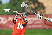 SHOT 8/16/14 4:21:57 PM - The Denver Outlaws Justin Pennington #14 fires a shot in front of a New York Lizards outstretched arm during their MLL Semifinals matchup at Peter Barton Lacrosse Stadium on the University of Denver campus in Denver, Co. Saturday. The Denver Outlaws won the game 14-13 to advance. (Photo by Marc Piscotty / © 2014)