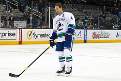 Sep 29, 2011; San Jose, CA, USA; Vancouver Canucks defenseman Keith Ballard (4) warms up before the game against the San Jose Sharks at HP Pavilion.  San Jose defeated Vancouver 3-0. Mandatory Credit: Jason O. Watson-US PRESSWIRE