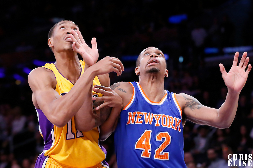 12 March 2015: New York Knicks forward Lance Thomas (42) vies for the rebound with Los Angeles Lakers forward Wesley Johnson (11) during the New York Knicks 101-94 victory over the Los Angeles Lakers, at the Staples Center, Los Angeles, California, USA.