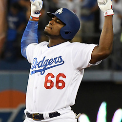 Los Angeles Dodgers' Yasiel Puig reacts after hitting a RBI double in the fifth inning of a National League Championship Series baseball game against the Chicago Cubs at Dodger Stadium on Saturday, Oct. 14, 2017 in Los Angeles. (Photo by Keith Birmingham, Pasadena Star-News/SCNG)