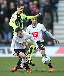 Karim Matmour of Huddersfield Town in action against Craig Bryson (L) and Marcus Olsson (R) of Derby County - Mandatory byline: Jack Phillips/JMP - 05/03/2016 - FOOTBALL - iPro Stadium - Derby, England - Derby County v Huddersfield Town - Sky Bet Championship