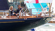 Olympic and America's Cup winning sailor, Sir Ben Ainslie, aboard his yacht Rita with girlfriend Georgie Thompson on the opening day of Aberdeen Asset Management Cowes Week. The pair sat on deck as the competitors finished racing on the opening day of the regatta. The event began in in 1826 and plays a key part in the British sporting summer 'season'. It now stages up to 40 daily races for around 1,000 boats and is the largest sailing regatta of its kind in the world with 8,500 sailors competing.<br />