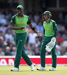 South Africa's Quinton de Kock (right) smiles after catching England's Jonny Bairstow during the ICC Cricket World Cup group stage match at The Oval, London.