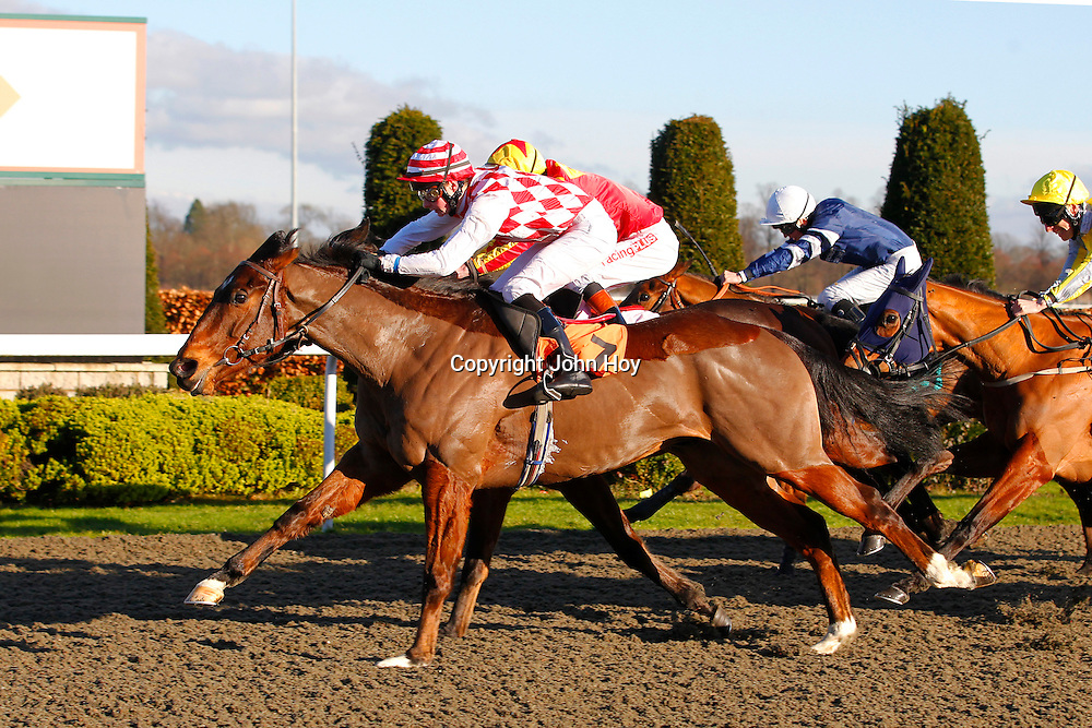 Spellmaker and E J Walsh winning the 1.30 race