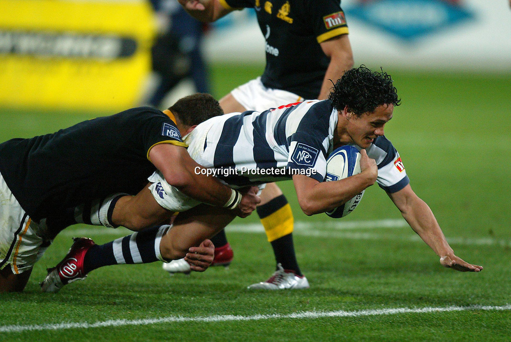 Auckland's Tasesa Lavea scores a try while being gets tackled by Lion's David Holwell during the Wellington Lions 27-21 win over Auckland on Saturday night at the Westpac Stadium, Wellington, New Zealand. NPC Div 1 <br /> 11 September 2004<br /> Photo: Marty Melville/Photosport