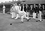 15/05/1965<br /> 05/15/1965<br /> 15 May 1965<br /> Inter-Association Bowling at Kennelworth, B.C. Dublin. Picture shows Mr E.V. Black, Woodvale B.C., Belfast delivering a wood during the Annual Irish Bowling Association Senior Inter-Association Match, Bowling League of Ireland v Northern Ireland Association, watched by H. Leckey, (9th Old Boys); S. Allen, (Connsbrook) and W.S. Tate, (Bangor) all Belfast and P. Noone, (Crumlin); J. Carleton, (Crumlin): T. Spollen, (St. James' Gate) and T. McAnneney, (Leinster).