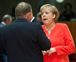 Angela Merkel, Germany's chancellor, right, speaks with Lars Lokke Rasmussen, Denmark's prime minister, during the European Summit meeting at EU Council headquarters in Brussels, Belgium, on Thursday, June 17, 2010. (Photo © Jock Fistick)