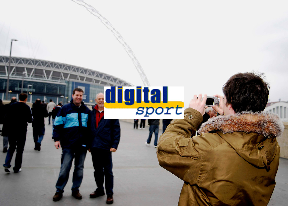 Photo: Alan Crowhurst.<br />England U21 v Italy U21. International Friendly. 24/03/2007. England fans have their pictures taken infront of the stadium.